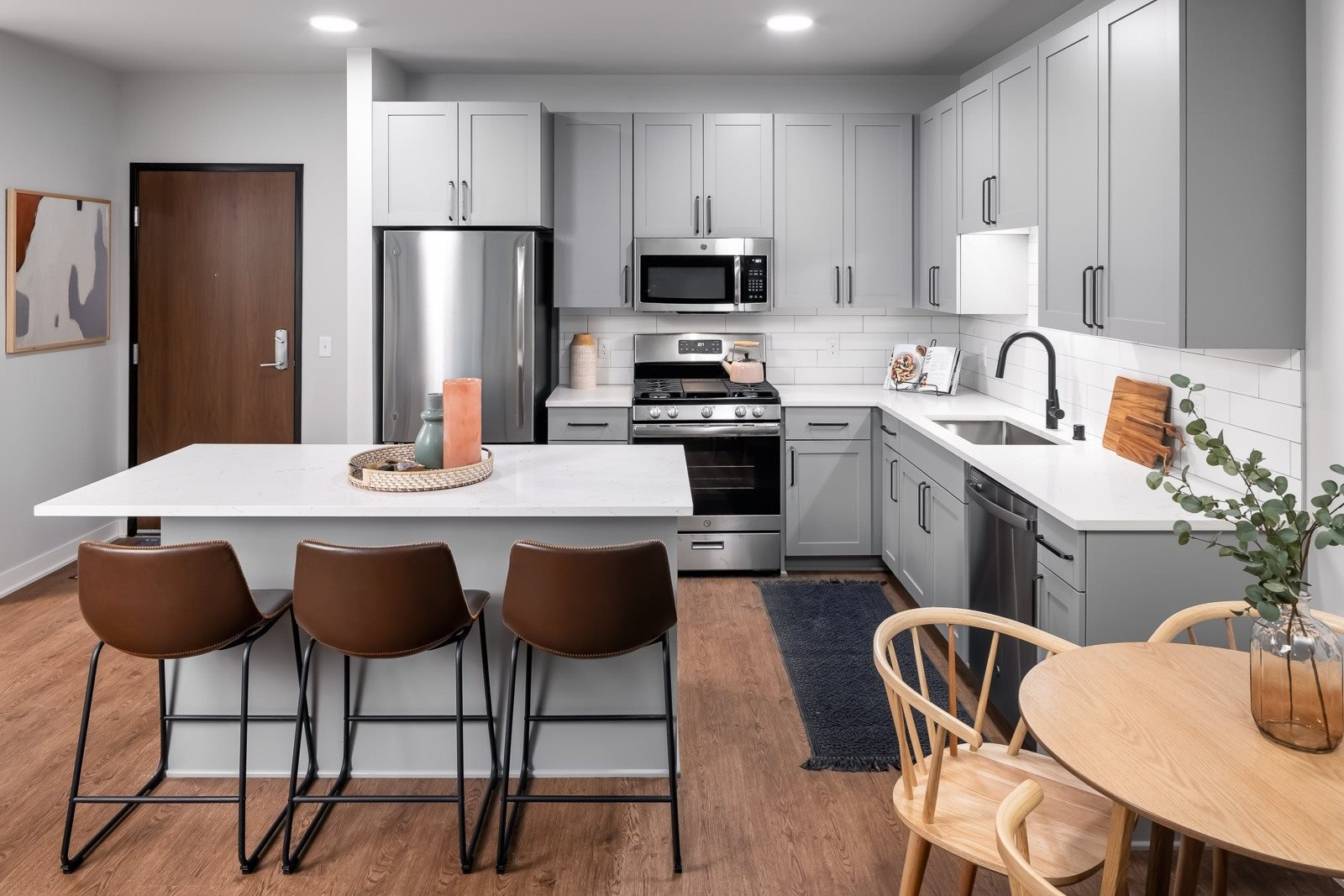 Eat-in kitchen with stainless steel appliances and backsplash