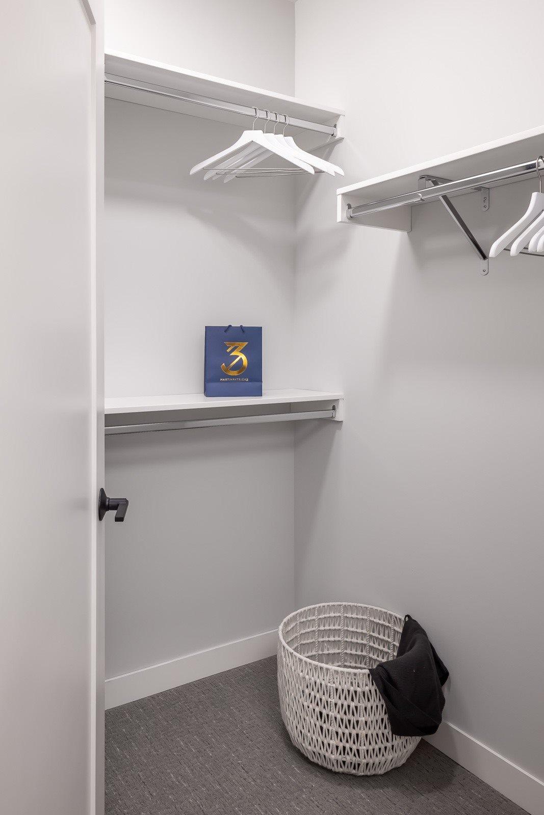 Custom closet built-ins in walk-in closet in one bedroom apartment unit