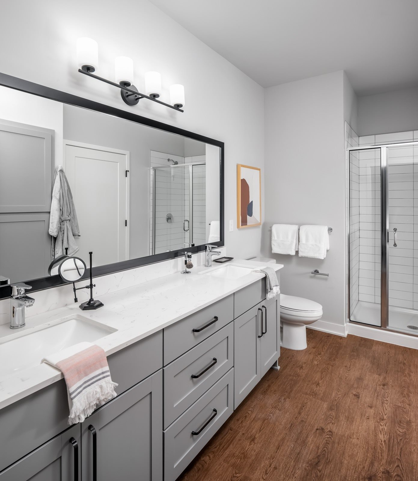 Designer bathroom with grey shaker cabinets and double vanity