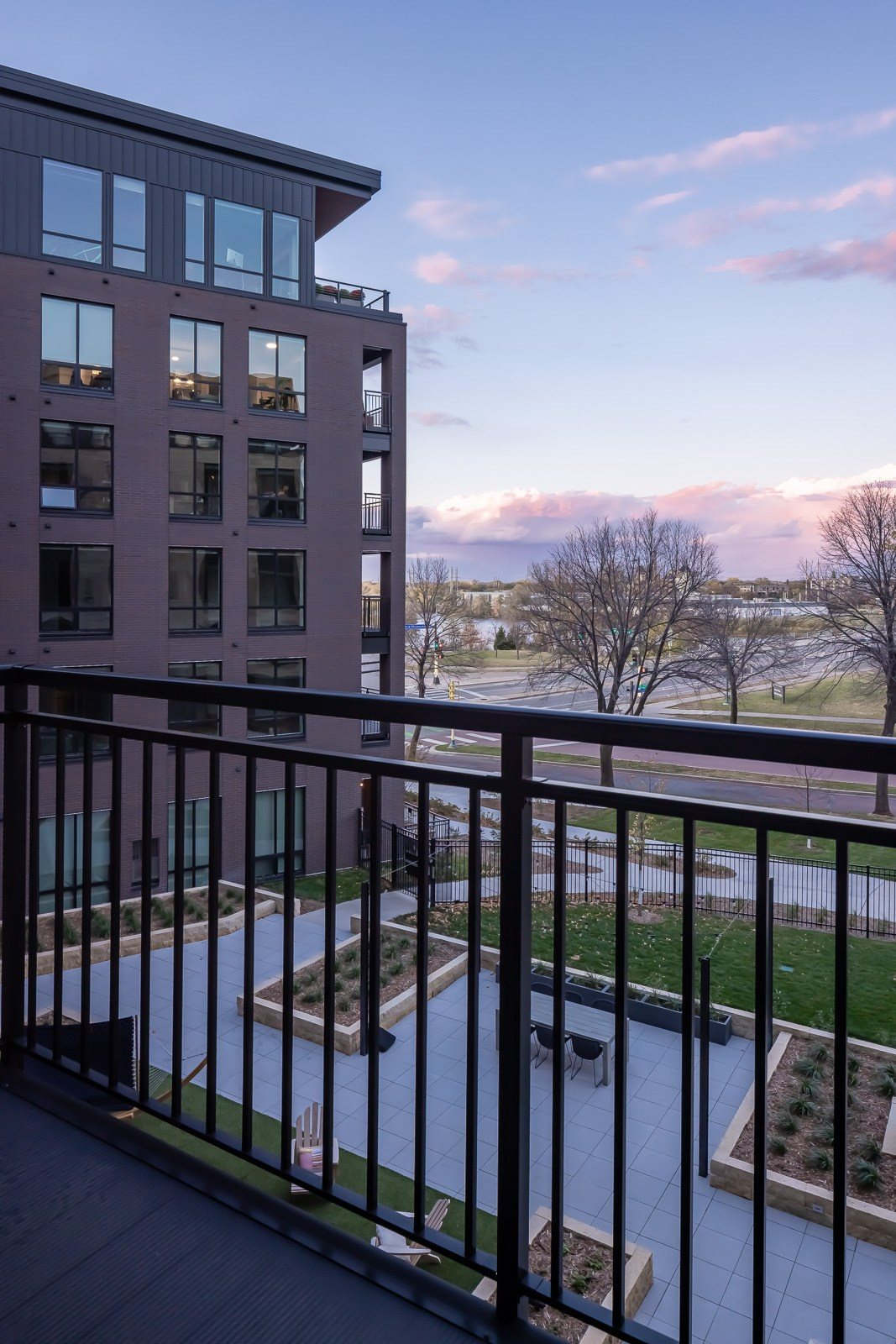 View over Mississippi river and entertaining terrace from apartment balcony