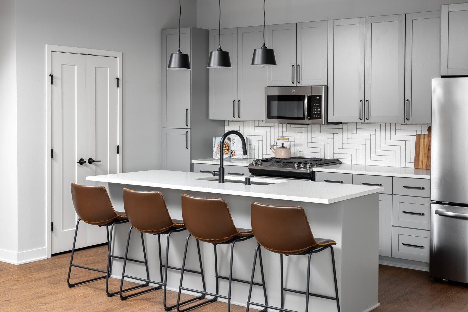 eat-in kitchen with designer fixtures and finishes in two bedroom apartment model