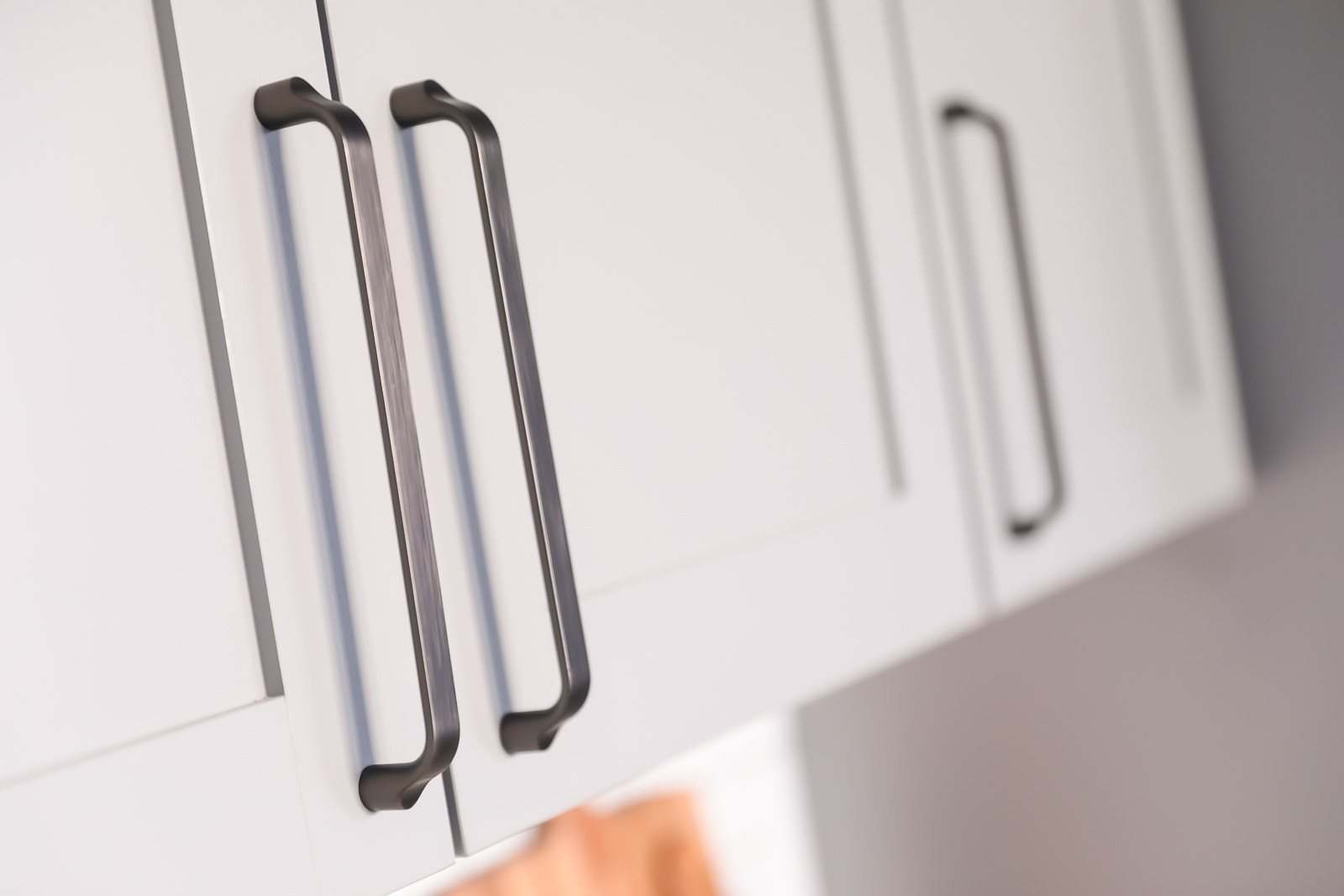 Designer cabinet pull handles on hand-crafted shaker style cabinets at Vesi
