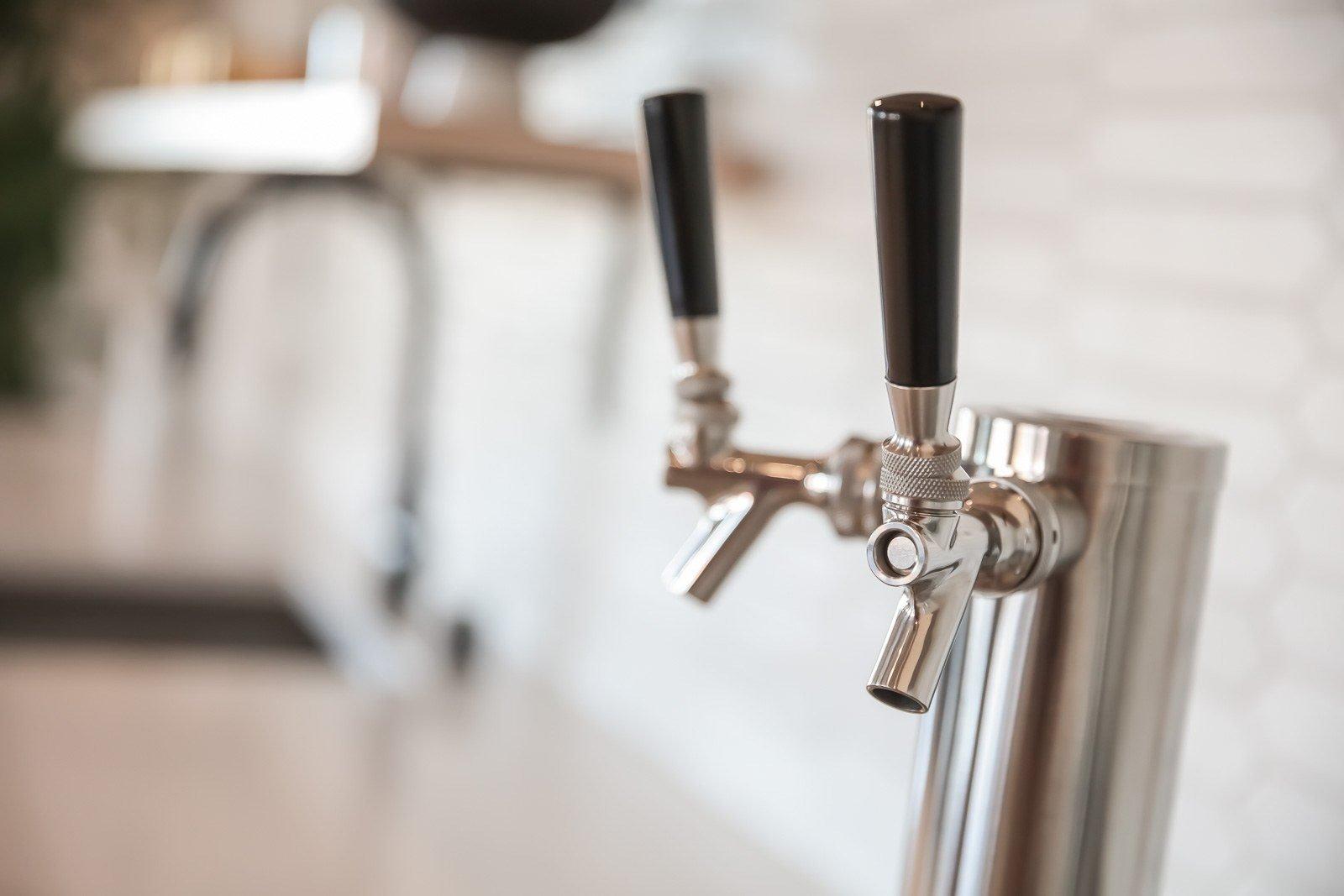 Rotating beer and kombucha tap in social lobby at Vesi