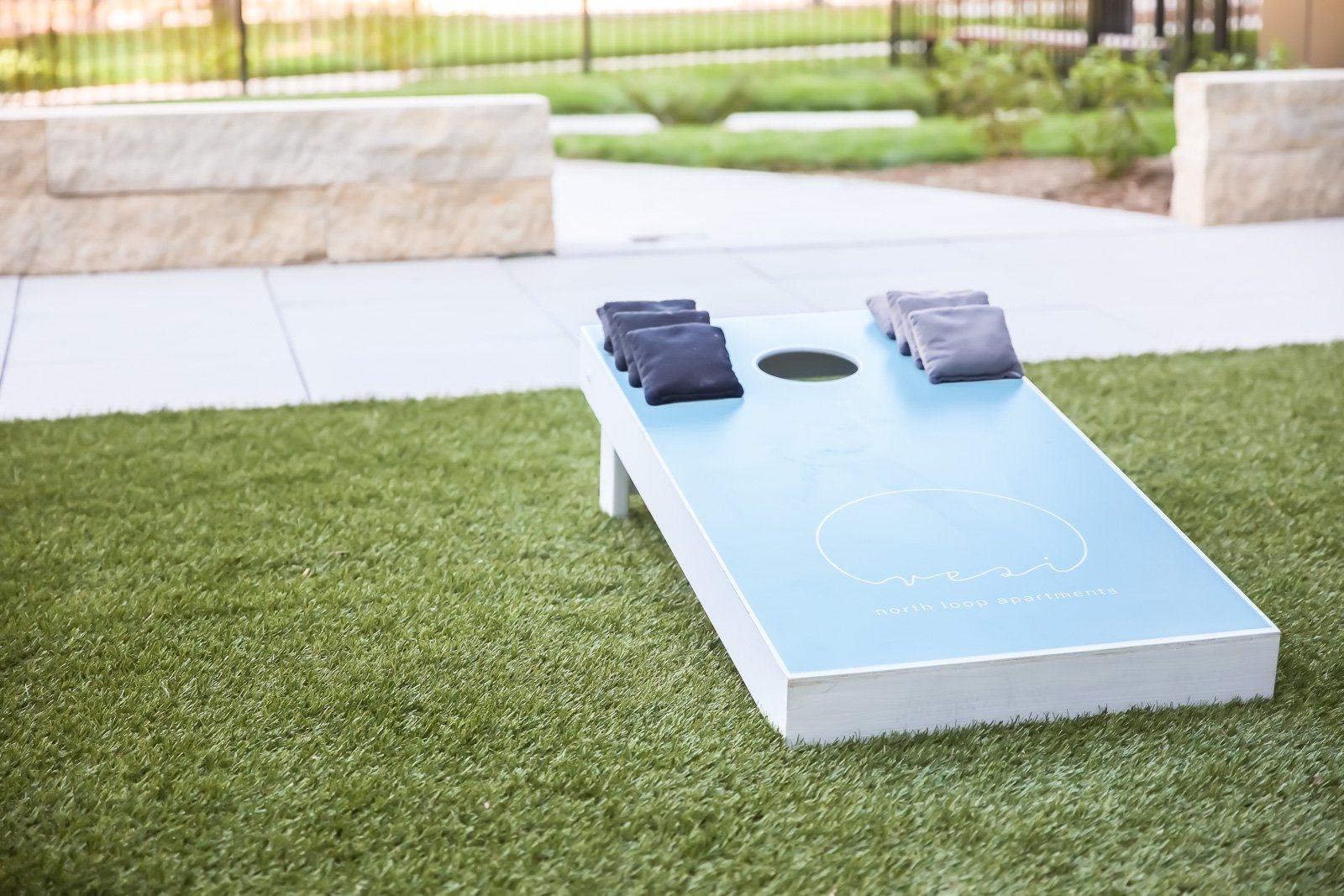Cornhole or Bean Bag toss on artificial turf