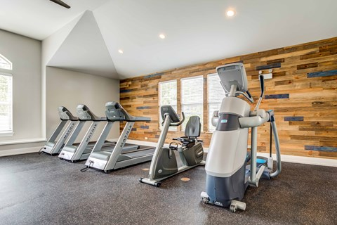 Fitness center with 3 treadmills and stairstepper