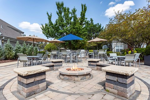 Outdoor lounge area with firepit