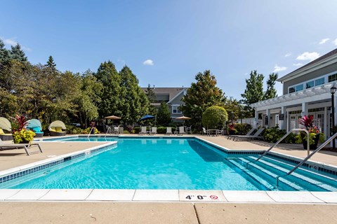 Legacy at Fox Valley Large Swimming Pool with Lounge Chairs, Cabanas, and Lush Landscaping