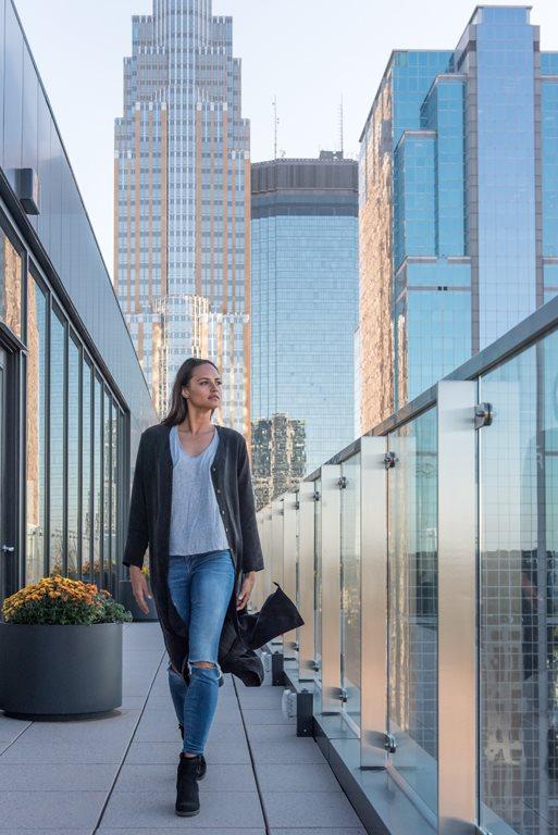 Girl walking on 365 Nicollet balcony