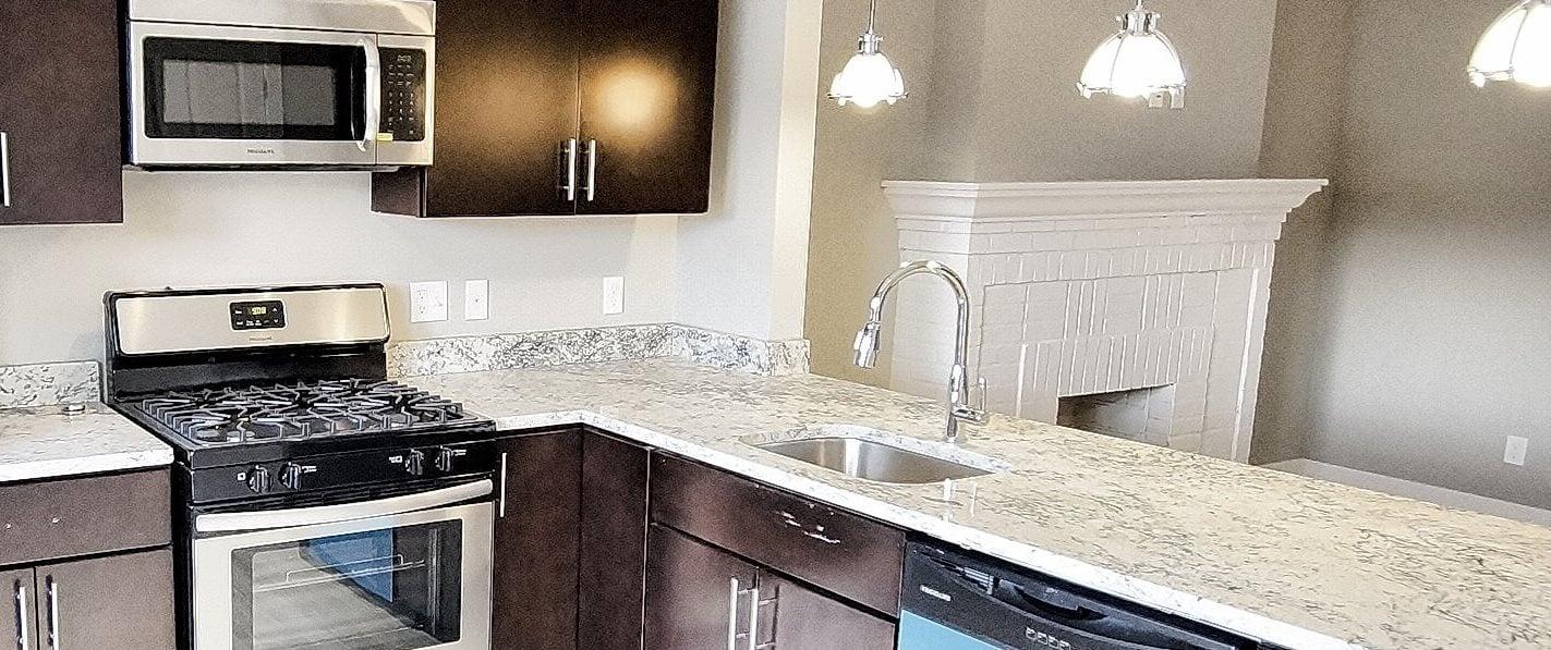 Granite Countertop Kitchen at Integrity Gold Coast Apartments, Lakewood, OH, 44102