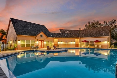 Bloomingdale Woods Apartments Valrico Florida Pool in Foreground with Clubhouse Rear surrounded by sunset