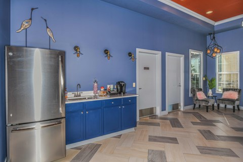 Bloomingdale Woods Apartments Valrico Florida Clubhouse Interior with Refrigerator, Coffee Nook, and Seating Area