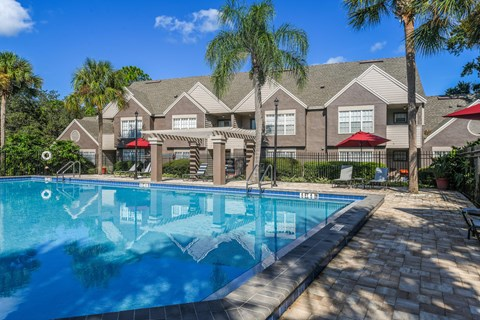 Bloomingdale Woods Apartments Valrico Florida Sunny Pool during day with Umbrellas and Building Exterior