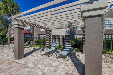 Bloomingdale Woods Apartments Valrico Florida Outdoor Pool During Day Chaise Lounge Chairs under Pergola