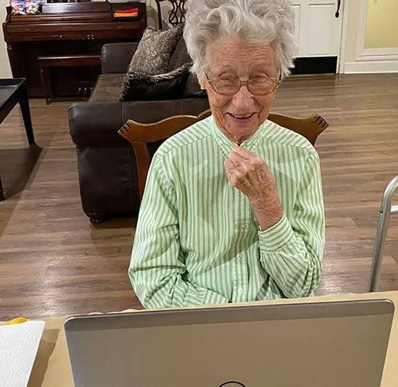 Senior Resident In-front Of Laptop at Savannah Court of Brandon, Brandon, Florida