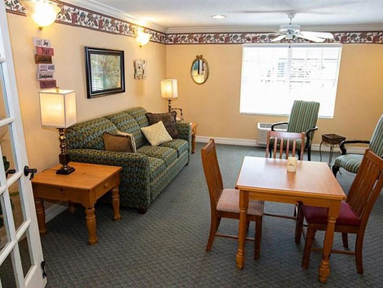 Living Room With Dining Area at Savannah Court of Orange City, Orange City, 32763