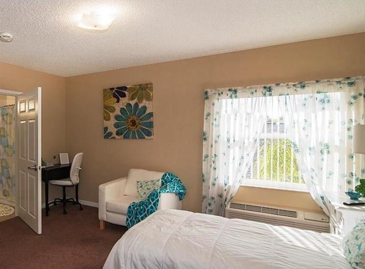 Bedroom With Window at Sun City Senior Living, Ruskin