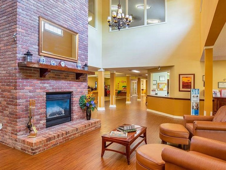 Classic Living Room Design With Fireplace at Sun City Senior Living, Ruskin, FL