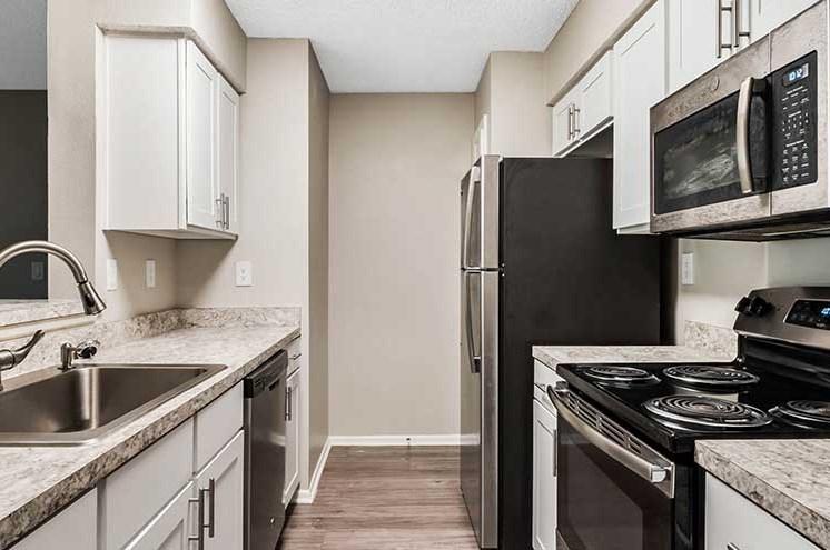 Granite Countertop Kitchen at Newport Colony Apartment Homes, Florida, 32707