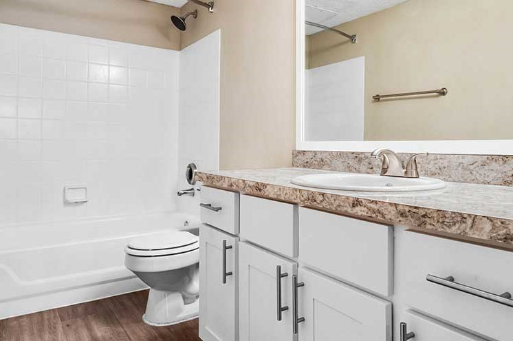 Bathroom With Bathtub at Newport Colony Apartment Homes, Casselberry