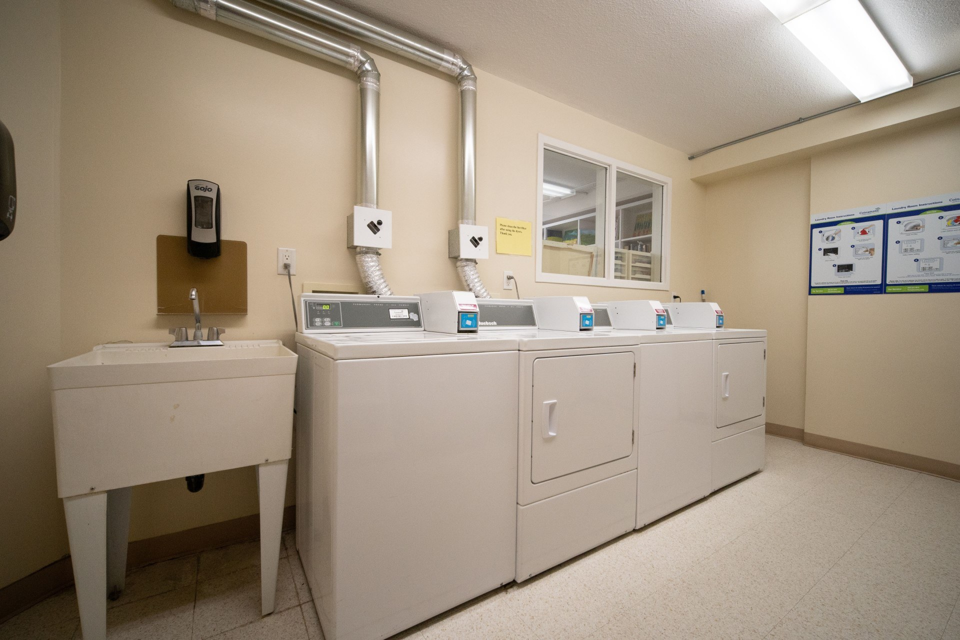Shared laundry room in Spruce community