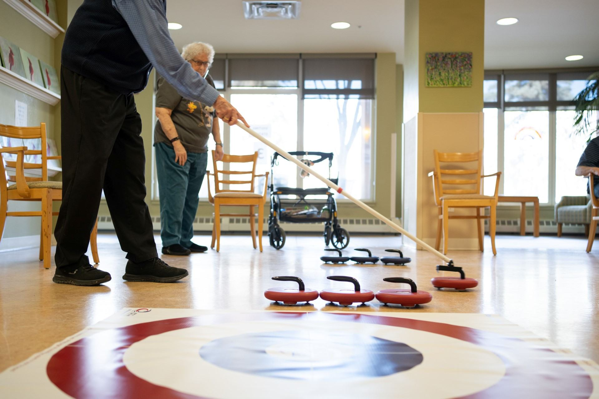 Residents playing a game of curling and living an active life