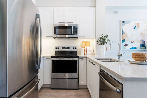 Inlet Glen Apartments in Port Moody, BC kitchen includes stainless appliances