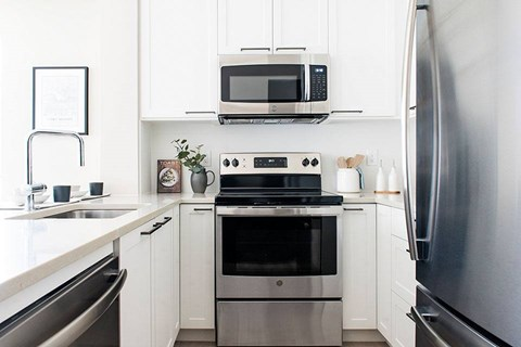 Inlet Glen Apartments in Port Moody, BC kitchen with stainless steel appliances