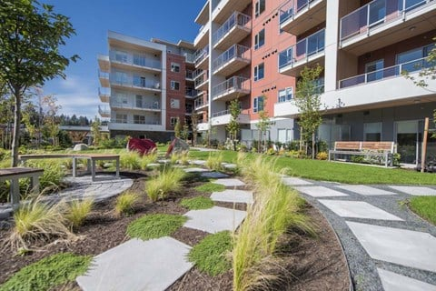 Inlet Glen Apartments property exterior featuring walkway in Port Moody, BC