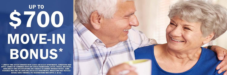 Happy senior couple featuring $700 move-in bonus