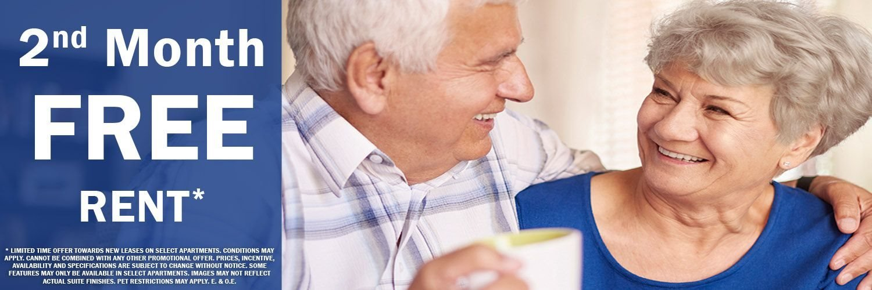 Happy senior couple featuring 2nd month free move-in bonus