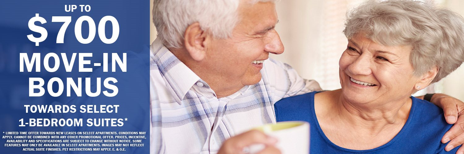 Happy senior couple featuring up to a $700 move-in bonus on select 1-bed suites*
