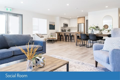 Inlet Glen Apartments Social Room featuring lounge seating and recessed lighting in Port Moody, BC