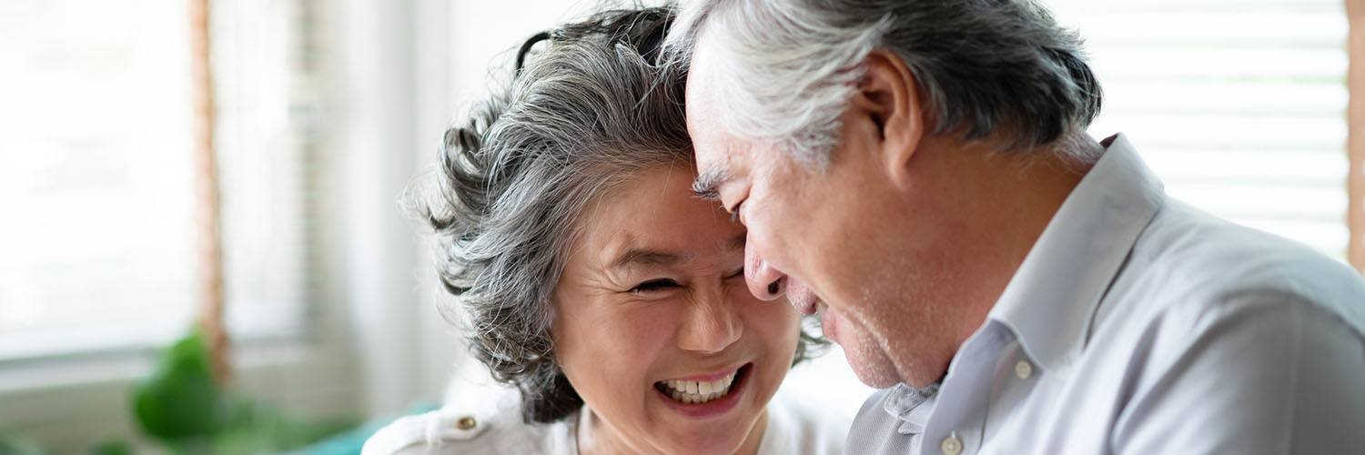 senior couple laughing in the kitchen