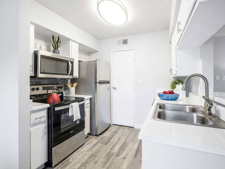 Fully equipped kitchens with stainless steel appliances