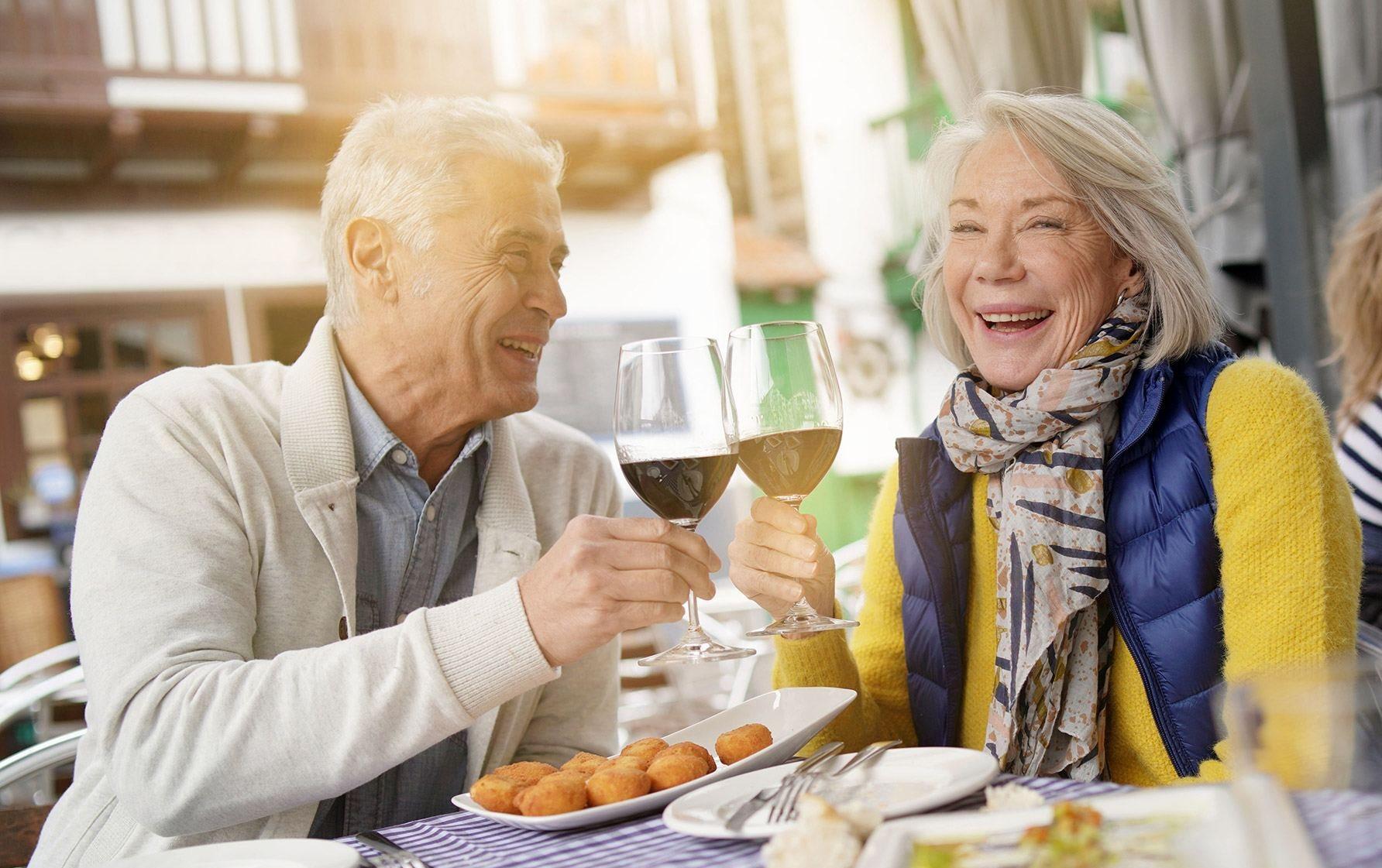 Happy Couple Enjoying Wine at Cogir of Stock Ranch, California, 95621