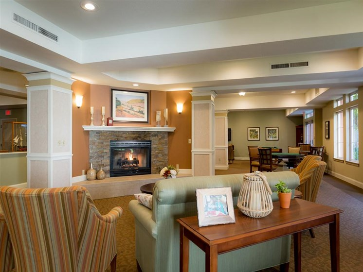 Posh Lounge Area With Fireplace In Clubhouse at Cogir of Stock Ranch, Citrus Heights, California