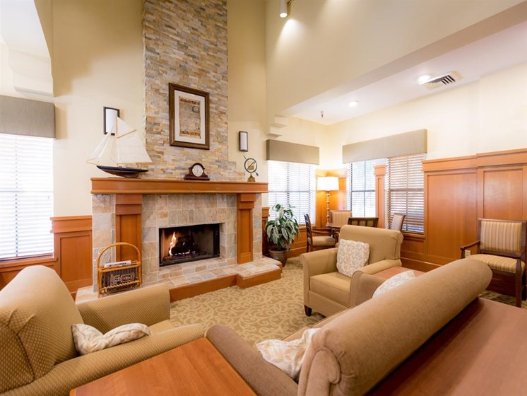 Posh Lounge Area With Fireplace In Clubhouse at Cogir of Vacaville, Vacaville, CA