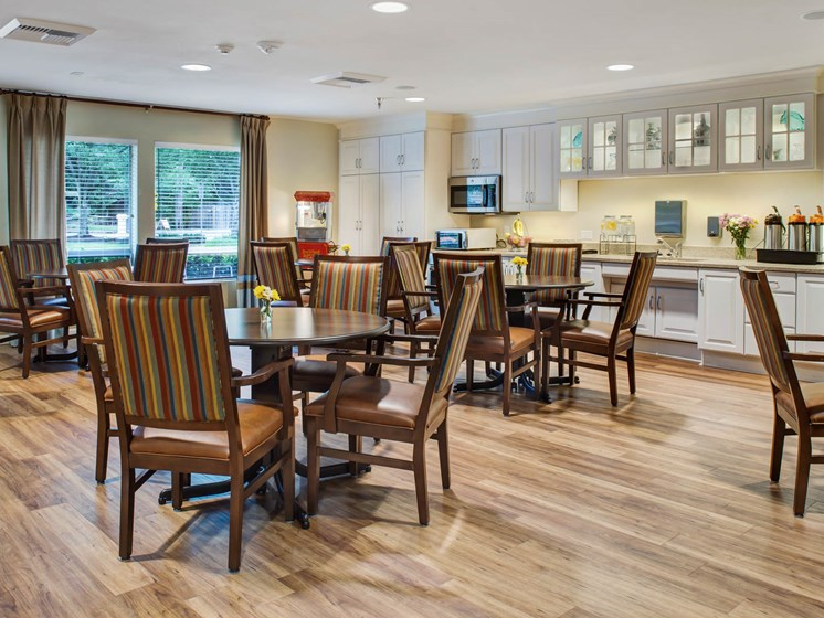 Dining room with tables and chairs at Cogir of San Rafael Memory Care, San Rafael