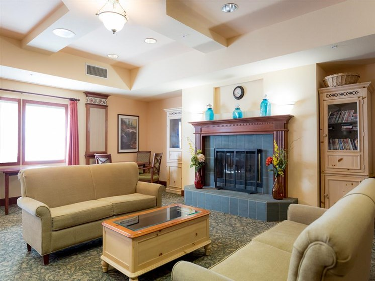 Lounge Area With Fireplace at Cogir of Mill Creek, Mill Creek