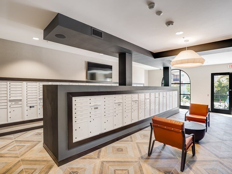 State of the Art Mail and Package Room with Parcel Lockers and Refrigerated Parcel Lockers at The Club at Enclave Apartments in Chula Vista, CA