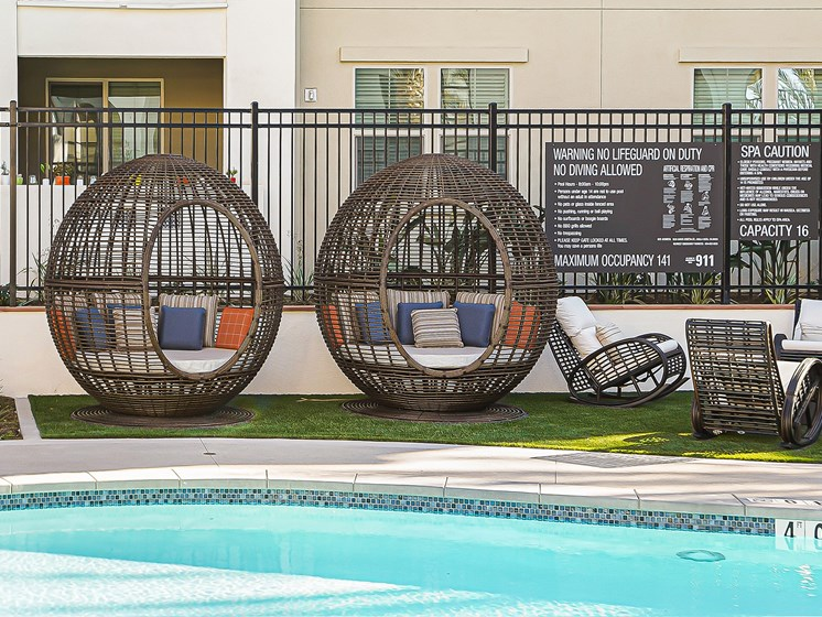 Poolside with Modern Seating and Loungers at The Club at Enclave Apartments in Chula Vista, CA