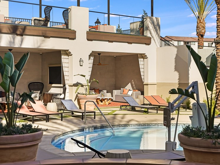 Sparkling Pool Overlooking Loungers and Private Poolside Cabanas with Flat Screen TVs at The Club at Enclave Apartments in Chula Vista, CA