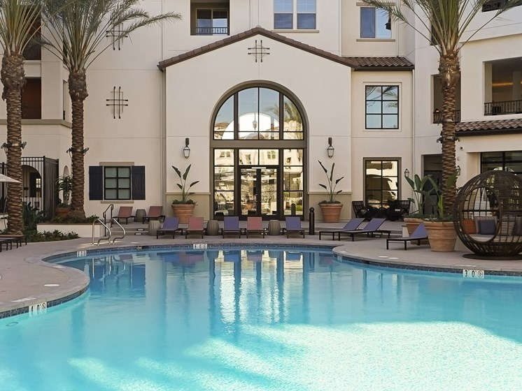 Resort Pool Loungers Luxury Living at The Club at Enclave Apartments in Chula Vista, CA