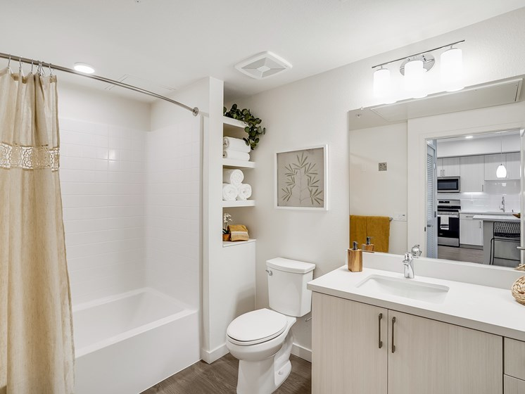 Modern Bathroom with New Cabinetry Quartz Counters Storage at The Club at Enclave Apartments in Chula Vista, CA