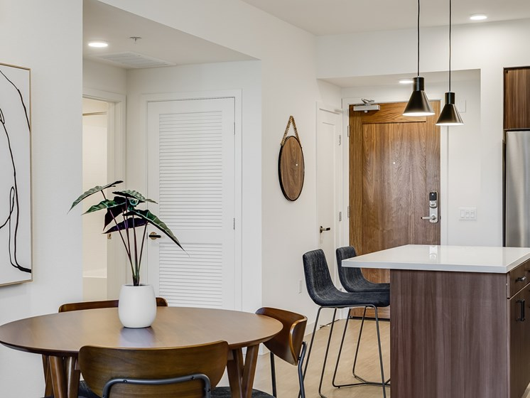 Mid Century Modern Penthouse Decor Dining Room Open Layout to Kitchen at The Club at Enclave Apartments in Chula Vista, CA