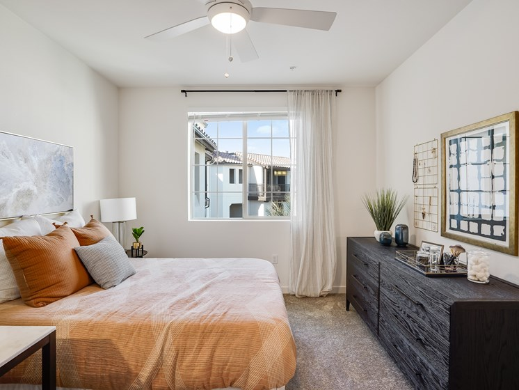Spacious Bedroom with Ceiling Fan Large Windows at The Club at Enclave Apartments in Chula Vista, CA