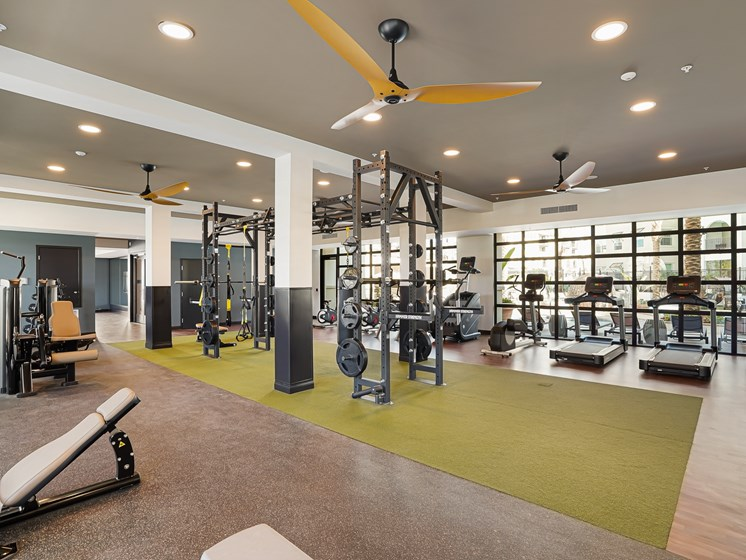 State of the Art Fitness Center with Treadmills Stairmaster Free Weights Bench TRX Spin Bikes at The Club at Enclave Apartments in Chula Vista, CA