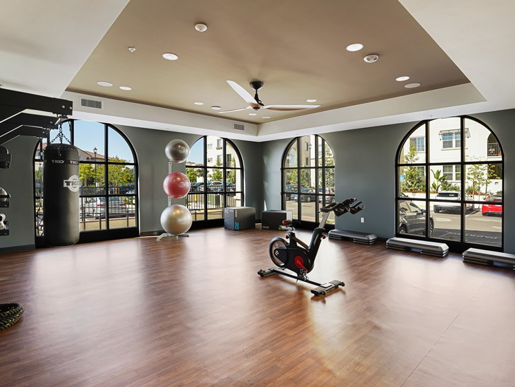 State of the Art Gym with Yoga Studio Stationary Bikes TRX Free Weights Kettlebell at The Club at Enclave Apartments in Chula Vista, CA