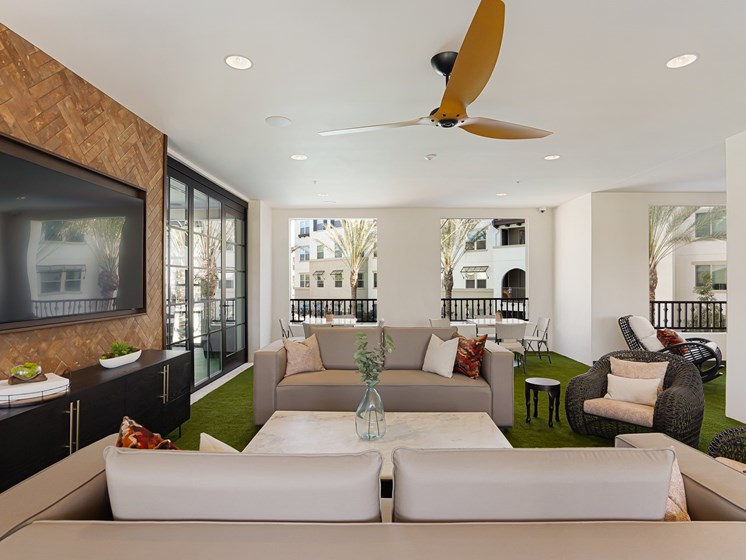 Outdoor Living Room Lounge Entertaining Space Overlooking Pool Area at The Club at Enclave Apartments in Chula Vista, CA