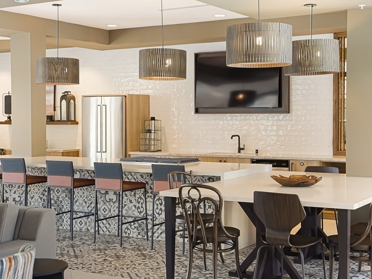 Gourmet Chef Kitchen with Italian Tile Quartz and Ample Seating for Events at The Club at Enclave Apartments in Chula Vista, CA